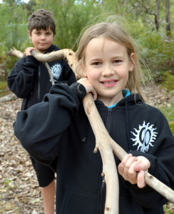 Back to nature MRIS students Jett Higgins (Yr 6) and Amelia Glass(Yr 5) start collecting suitable material to build cubbies in the school grounds.