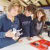 Year 6 students Billy Freeman, Sholto Armstrong and Nava Wilson-Mirzaei construct a robot.