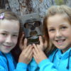 Action: Lowana O'Grady and Willow Hardy  (yr 4)  with a state-of-the-art infra-red camera which will track fauna in MRIS bushland.