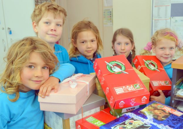 Reaching out: MRIS students, Sol, Finn, Evie, Fiona and Maisy with the Operation Christmas Child boxes.