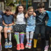 Sock it to me: Emma, Tex, Holly, Claudia, Rudy & Charley embraced Odd Socks Day.